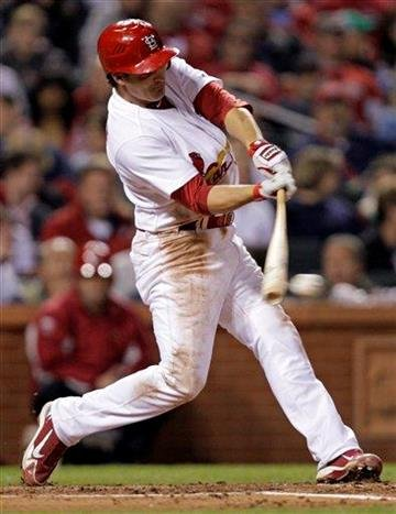 St. Louis Cardinals' Ryan Theriot connects for a single during the fifth inning of a baseball game against the Pittsburgh Pirates on Tuesday, April 5, 2011, in St. Louis.(AP Photo/Tom Gannam) By Tom Gannam