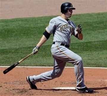 Pittsburgh Pirates' Neil Walker hits a solo home run during the fifth inning of a baseball game against the St. Louis Cardinals, Wednesday, April 6, 2011, in St. Louis. (AP Photo/Jeff Roberson) By Jeff Roberson