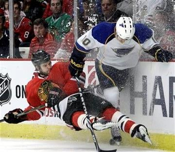 St. Louis Blues' Andy McDonald, right, battles Chicago Blackhawks' Brent Seabrook for the puck during the first period of an NHL hockey game in Chicago, Wednesday, April 6, 2011. (AP Photo/Nam Y. Huh) By Nam Y. Huh