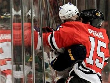 St. Louis Blues' TJ Oshie, left, is checked by Chicago Blackhawks' Fernando Pisani during the first period of an NHL hockey game in Chicago, Wednesday, April 6, 2011. (AP Photo/Nam Y. Huh) By Nam Y. Huh