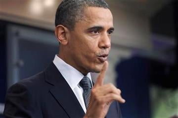 President Barack Obama gestures while speaking about the possible government shutdown, Tuesday, April 5, 2011, at the White House in Washington. (AP Photo/Charles Dharapak) By Charles Dharapak