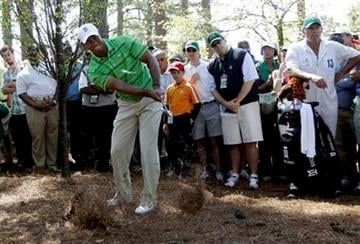 Tiger Woods hits out of the rough off the third hole during the first round of the Masters golf tournament Thursday, April 7, 2011, in Augusta, Ga. (AP Photo/David J. Phillip) By David J. Phillip