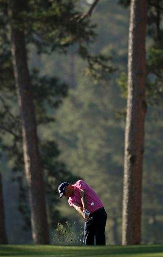 Gregory Havret of France hits off the first fairway during the first round of the Masters golf tournament Thursday, April 7, 2011, in Augusta, Ga. (AP Photo/David J. Phillip) By David J. Phillip