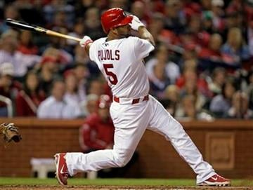 St. Louis Cardinals' Albert Pujols (5) watches his RBI single during the seventh inning of a baseball game against the Pittsburgh Pirates on Tuesday, April 5, 2011, in St. Louis. (AP Photo/Tom Gannam) By Tom Gannam