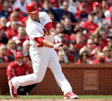 St. Louis Cardinals' Matt Holliday hits an RBI single during the first inning of a baseball game against the San Diego Padres Thursday, March 31, 2011, in St. Louis. (AP Photo/Tom Gannam) By Tom Gannam