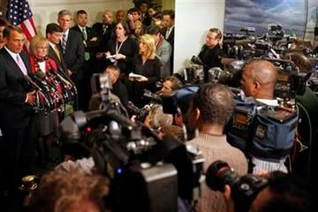 Surrounded by news media, House Speaker John Boehner, of Ohio, far left, announces that an agreement to avert a government shutdown was reached at the U.S. Capitol in Washington, on Friday, April 8, 2011. (AP Photo/Jacquelyn Martin) By Jacquelyn Martin