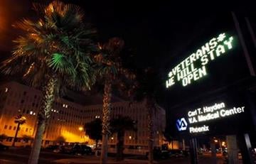 Ahead of a budget compromise that kept the federal government running, the the Veterans Administration hospital in Phoenix let it's patients know that they would not be affected late Friday, April 8, 2011. (AP Photo/Ross D. Franklin) By Ross D. Franklin