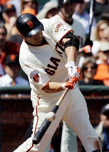 San Francisco Giants' Freddy Sanchez drives in a runs with a double against the St. Louis Cardinals during the third inning of a baseball game in San Francisco,  Friday, April 8, 2011. (AP Photo/Marcio Jose Sanchez) By Marcio Jose Sanchez