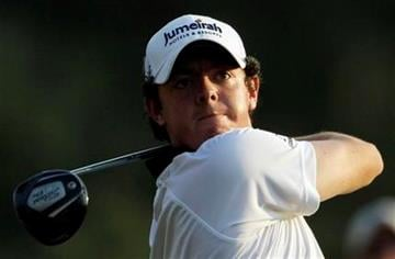 Rory McIlroy of Northern Ireland tees off on the 18th hole during the third round of the Masters golf tournament Saturday, April 9, 2011, in Augusta, Ga. (AP Photo/David J. Phillip) By David J. Phillip