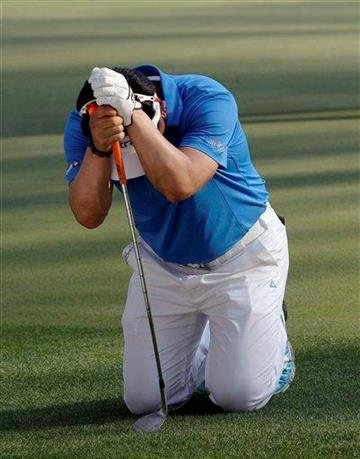 Y.E. Yang of Korea reacts after a missed birdie chip during the third round of the Masters golf tournament Saturday, April 9, 2011, in Augusta, Ga. (AP Photo/Dave Martin) By Dave Martin