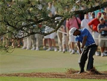 Tiger Woods hits out of the rough on the 17th hole during the third round of the Masters golf tournament Saturday, April 9, 2011, in Augusta, Ga. (AP Photo/Chris O'Meara) By Chris O'Meara