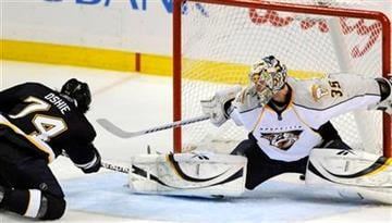 Nashville Predators' goalie Pekka Rinne (35), of Finland, cannot block the shot by St. Louis Blues' TJ Oshie, left, in the second period of an NHL hockey game on Saturday, April 9, 2011, in St. Louis. The Blues won 2-0. (AP Photo/Bill Boyce) By Bill Boyce