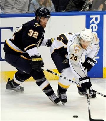 St. Louis Blues' Chris Porter (32) and Nashville Predators' Matt Halischuk (24) reach for a loose puck in the second period of an NHL hockey game on Saturday, April 9, 2011, in St. Louis. (AP Photo/Bill Boyce) By Bill Boyce