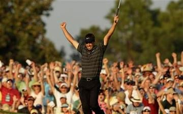 Charl Schwartzel of South Africa reacts after a birdie putt on the 18th hole during the final round of the Masters golf tournament Sunday, April 10, 2011, in Augusta, Ga. (AP Photo/Charlie Riedel) By Charlie Riedel