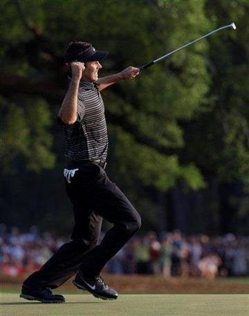 Charl Schwartzel of South Africa reacts after a birdie putt on the 18th hole during the final round of the Masters golf tournament Sunday, April 10, 2011, in Augusta, Ga.  (AP Photo/David J. Phillip) By David J. Phillip