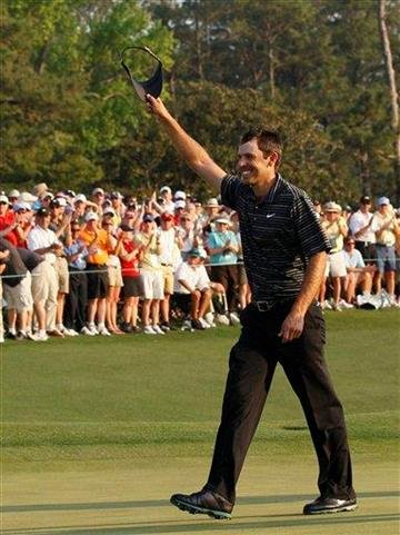 Charl Schwartzel of South Africa reacts after making a birdie putt on the 18th hole during the final round of the Masters golf tournament Sunday, April 10, 2011, in Augusta, Ga. (AP Photo/Matt Slocum) By Matt Slocum