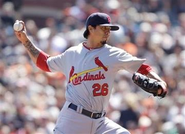 St. Louis Cardinals starting pitcher Kyle Lohse throws against the San Francisco Giants during the first inning of a baseball game in San Francisco, Sunday, April, 10, 2011. (AP Photo/Eric Risberg) By Eric Risberg