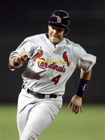 St. Louis Cardinals' Yadier Molina sprints around third base to score a run on a double by Kyle McClellan against the Arizona Diamondbacks in the third inning of a baseball game Monday, April 11, 2011, in Phoenix. (AP Photo/Paul Connors) By Paul Connors