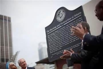 A civil war marker in commemoration of the Battle of Atlanta is unveiled as Georgia Historical Society board member Bill Todd, left, looks on during a ceremony Monday, April 11, 2011 in Atlanta. (AP Photo/David Goldman) By David Goldman
