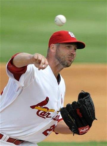 St. Louis Cardinals starting pitcher Chris Carpenter throws during the second inning of a spring training baseball game against the Washington Nationals, Monday, March 21, 2011, in Jupiter, Fla. (AP Photo/Carlos Osorio) By Carlos Osorio