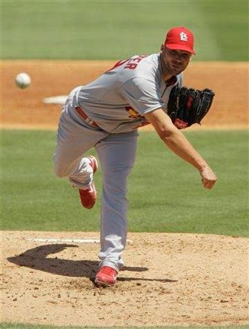 St. Louis Cardinals starting pitcher Chris Carpenter (29) throws during the third inning of a spring training baseball game against the Florida Marlins, Saturday, March 26, 2011 in Jupiter, Fla. (AP Photo/Carlos Osorio) By Carlos Osorio