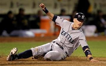 Seattle Mariners' Brendan Ryan slides to score during the seventh inning of a baseball game against the Oakland Athletics Saturday, April 2, 2011, in Oakland, Calif. Ryan scored on a sacrifice fly by Michael Saunders. (AP Photo/Ben Margot) By Ben Margot