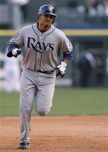 Tampa Bay Rays' Felipe Lopez rounds the bases after hitting a solo home run against the Chicago White Sox during the ninth inning of a baseball game in Chicago, Saturday, April 9, 2011. The White Sox won 4-2. (AP Photo/Nam Y. Huh) By Nam Y. Huh