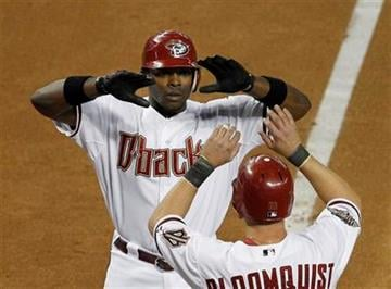 Arizona Diamondbacks' Justin Upton, left, celebrates with Willie Bloomquist after Upton's home run against the St. Louis Cardinals in the second inning of a baseball game Tuesday, April 12, 2011, in Phoenix. (AP Photo/Ross D. Franklin) By Ross D. Franklin
