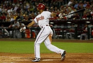Arizona Diamondbacks' Chris Young watches his home run against the St. Louis Cardinals in the fourth inning of an MLB baseball game Tuesday, April 12, 2011, in Phoenix. (AP Photo/Ross D. Franklin) By Ross D. Franklin