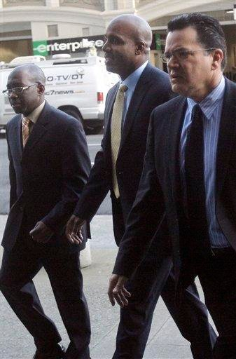 Former baseball player Barry Bonds, center, arrives at federal court for jury deliberations in his perjury trial in San Francisco, Tuesday, April 12, 2011. (AP Photo/Jeff Chiu) By Jeff Chiu