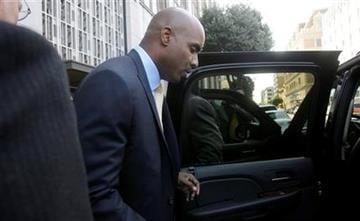 Former baseball player Barry Bonds leaves federal court after jury deliberations in his perjury trial in San Francisco, Tuesday, April 12, 2011. (AP Photo/Jeff Chiu) By Jeff Chiu
