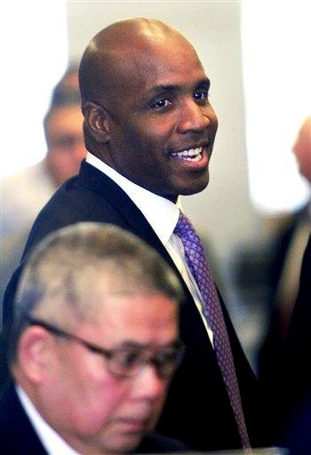 Former baseball player Barry Bonds passes through security at federal court as a jury deliberates perjury charges against him on Wednesday, April 13, 2011, in San Francisco. (AP Photo/Noah Berger) By Noah Berger
