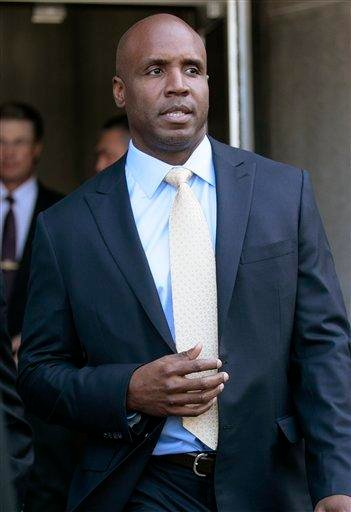 Former baseball player Barry Bonds leaves federal court in his perjury trial in San Francisco, Tuesday, April 12, 2011. Jurors spent a third day in deliberations without reaching a verdict. (AP Photo/Jeff Chiu) By Jeff Chiu