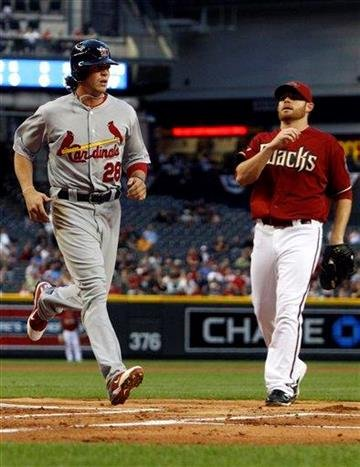 St. Louis Cardinals' Colby Rasmus (28) scores on a wild pitch by Arizona Diamondbacks' Ian Kennedy, right, in the first inning of an MLB baseball game on Wednesday, April 13, 2011, in Phoenix. (AP Photo/Ross D. Franklin) By Ross D. Franklin