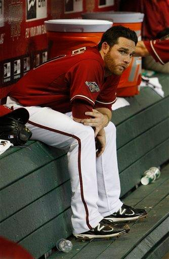 Arizona Diamondbacks' Ian Kennedy sits in the dugout after giving up nine runs to the St. Louis Cardinals in the first three innings of an MLB baseball game on Wednesday, April 13, 2011, in Phoenix. (AP Photo/Ross D. Franklin) By Ross D. Franklin