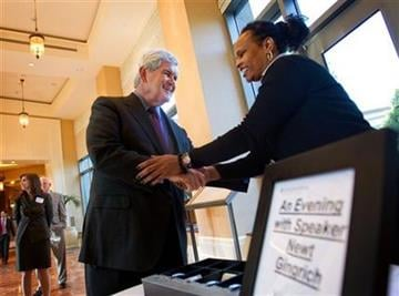 Former House Speaker Newt Gingrich, left, greets valet parking attendant Neggla Aly, as he arrives for a 2012 presidential exploratory committee fundraising event Wednesday, April 13, 2011 in Atlanta. (AP Photo/David Goldman) By David Goldman