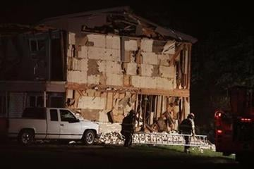 Rescue workers pass a damaged apartment complex after a nearby fertilizer plant exploded Wednesday, April 17, 2013, in West, Texas. (AP Photo/ Waco Tribune Herald, Rod Aydelotte) By Rod Aydelotte