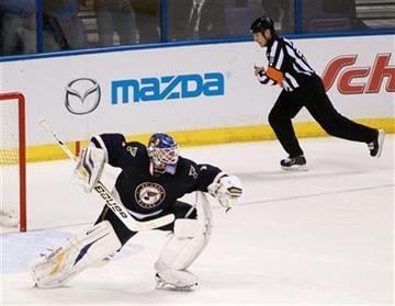 St. Louis Blues goaltender Brian Elliott reacts after shutting out the Phoenix Coyotes during the shootout of their NHL hockey game, Thursday, April 18, 2013, in St. Louis. The Blues won 2-1. (AP Photo/St. Louis Post-Dispatch, Chris Lee) By Chris Lee