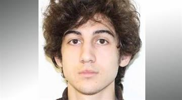 "The FBI has released an image of the surviving bomb suspect known as Dzhokhar A. Tsarnaev, a 19-year-old who had been living in Cambridge, just outside Boston, and said he ""may be armed and dangerous."" By Brendan Marks"