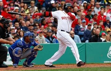 BOSTON, MA - APRIL 20:  David Ortiz #34 of the Boston Red Sox singles in the fourth inning against the Kansas City Royals at Fenway Park on April 20, 2013 in Boston, Massachusetts.  (Photo by Jim Rogash/Getty Images) By Jim Rogash