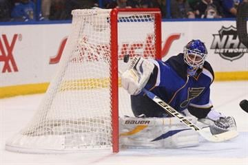 FILE PHOTO -- Brian Elliott #1 of the St. Louis Blues makes a save against the Dallas Stars during the second period at the Scottrade Center on April 19, 2013 in St. Louis, Missouri.  (Photo by Dilip Vishwanat/Getty Images) By Dilip Vishwanat