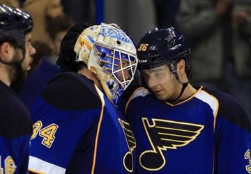 FILE PHOTO -- St. Louis Blues goaltender Jake Allen (L) is congratulated by teammate Matt D'Agostini after the final horn, defeating the San Jose Sharks 4-2, at the Scottrade Center in St. Louis on March 12, 2013.    UPI/Bill Greenblatt By BILL GREENBLATT