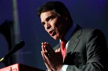 FILE - In this Jan. 16, 2012 file photo, Republican presidential candidate, Texas Gov. Rick Perry campaigns in Myrtle Beach, S.C. AP Source says Texas Gov. Rick Perry abandoning presidential bid.  (AP Photo/Charles Dharapak, File) By Charles Dharapak