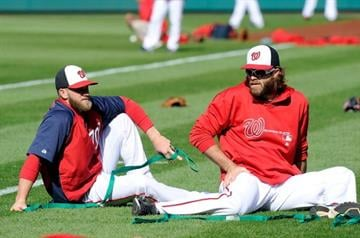 WASHINGTON, DC - APRIL 23:  Bryce Harper #34 and Jayson Werth #28 of the Washington Nationals warm up before the game against the St. Louis Cardinals at Nationals Park on April 23, 2013 in Washington, DC.  (Photo by Greg Fiume/Getty Images) By Greg Fiume
