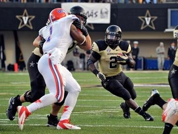 NASHVILLE, TN - OCTOBER 13:  Zac Stacy #2 of the Vanderbilt Commodores rushes against the Florida Gators at Vanderbilt Stadium on October 13, 2012 in Nashville, Tennessee.  (Photo by Frederick Breedon/Getty Images) By Frederick Breedon