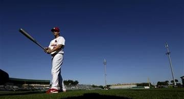 St. Louis Cardinals third baseman David Freese poses for a photograph during the team's photo day at spring training baseball, Tuesday, Feb. 19, 2013, in Jupiter, Fla. (AP Photo/Julio Cortez) By Julio Cortez
