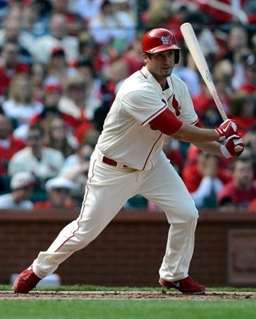 ST. LOUIS, MO - APRIL 13: David Freese #23 of the St. Louis Cardinals hits a double during the third inning against the Milwaukee Brewers at Busch Stadium on April 13, 2013 in St. Louis, Missouri.  (Photo by Jeff Curry/Getty Images) By Jeff Curry