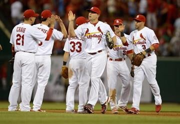 ST. LOUIS, MO - APRIL 30: Matt Holliday #7 of the St. Louis Cardinals high fives teammates after defeating the Cincinnati Reds at Busch Stadium on April 30, 2013 in St. Louis, Missouri.  (Photo by Jeff Curry/Getty Images) By Jeff Curry