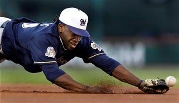 Milwaukee Brewers second baseman Rickie Weeks dives but cannot reach a ball hit for a single by St. Louis Cardinals' Colby Rasmus during the first inning of a baseball game Friday, July 2, 2010, in St. Louis. (AP Photo/Jeff Roberson) By Jeff Roberson