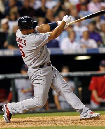 St. Louis Cardinals' Albert Pujols follows through on a single against the Colorado Rockies to lead off the fifth inning of a baseball game in Denver on Tuesday, July 6, 2010. (AP Photo/David Zalubowski) By David Zalubowski